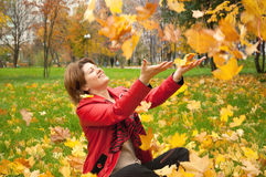 woman in autumn park with the leaves Royalty Free Stock Photography