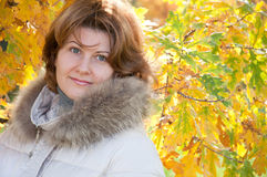 woman in autumn park with the leaves Stock Image