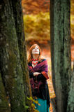 Woman in autumn park. With leaves in hands stock photos