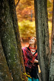 Woman in autumn park. With leaves in hands royalty free stock photography