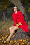Woman at autumn park with mapple leaves Royalty Free Stock Photo