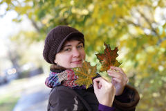 Woman at autumn park Royalty Free Stock Image