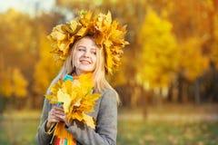 Woman in autumn park Stock Photos