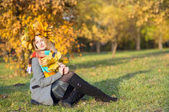 Woman in autumn park Stock Images