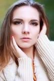 Woman autumn portrait. Young slim woman autumn portrait. Yellow orange colors royalty free stock photography