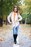 Woman autumn portrait. Young slim woman autumn portrait. Yellow orange colors royalty free stock images