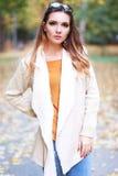 Woman autumn portrait. Young slim woman autumn portrait. Yellow orange colors royalty free stock photos