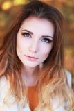 Woman autumn portrait. Young slim woman autumn portrait. Yellow orange colors stock photography