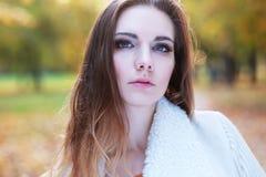 Woman autumn portrait. Young slim woman autumn portrait. Yellow orange colors stock photo