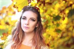 Woman autumn portrait. Young slim woman autumn portrait. Yellow orange colors royalty free stock photo