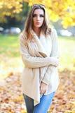 Woman autumn portrait. Young slim woman autumn portrait. Yellow orange colors stock image