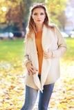 Woman autumn portrait. Young slim woman autumn portrait. Yellow orange colors royalty free stock image