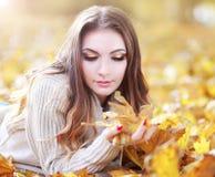 Woman autumn portrait. Young slim woman autumn portrait. Yellow orange colors royalty free stock images
