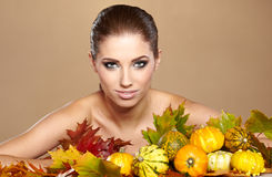 Woman with autumn pumpkin. And leaves royalty free stock photos
