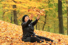 Woman and autumn scenery Stock Photography