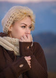 Woman at autumn sunset. Portrait of a young woman as evening falls in autumn cold Royalty Free Stock Photography