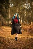 Woman In Autumn Woodland. Woman in vintage clothing and coat in woodland in the UK Royalty Free Stock Images