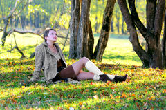 Woman in the autumn woods Stock Images