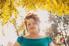 Woman with autumn wreath Stock Photos