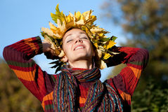 Woman with autumn wreath on her head Royalty Free Stock Photography
