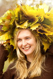 Woman with autumn wreath outdoors Stock Photo