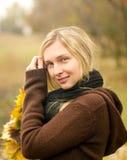 Woman with autumn wreath outdoors Stock Photos