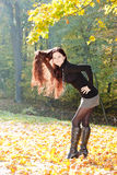 Woman in autumnal nature Royalty Free Stock Images