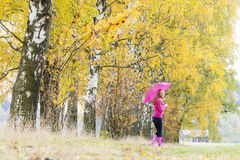 Woman in autumnal nature Stock Photo