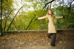 Woman in autumnal park Stock Image