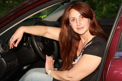 The woman of average years drives the car Stock Photos