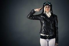 Woman with aviator helmet saluting Stock Images