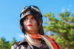 Woman in aviator helmet on the sky background Stock Photography