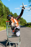 Woman in aviator helmet on the trolley with toy airplane Stock Photography