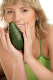 Woman with avocado Royalty Free Stock Images