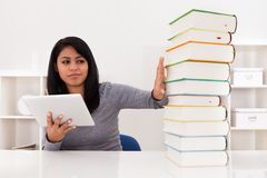 Woman Avoiding Books And Using Tablet Stock Photography