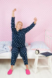 Woman awakening. Woman stretching after awakening in the morning Royalty Free Stock Image