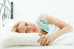 Woman awaking in  bed Stock Photos