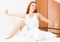 Woman awaking  in  bed at home Stock Photo