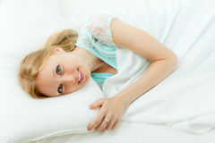 Woman awaking in her bed Stock Image