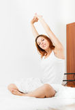Woman awaking up on white sheet Royalty Free Stock Photo