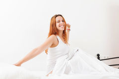 Woman awaking on white sheet in her bed at home Royalty Free Stock Photography