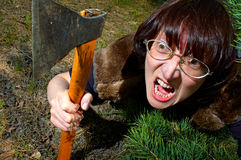 Woman with axe Royalty Free Stock Image