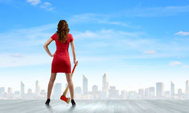 Woman with axe Stock Image