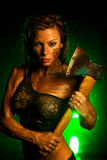 Woman with axe. Young strong woman with axe stock images