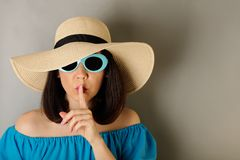 Woman in azure dress, hat and sunglasses. Selective focus Royalty Free Stock Image