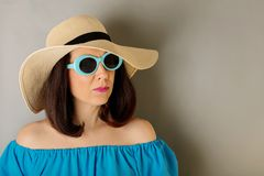 Woman in azure dress, hat and sunglasses. Selective focus Stock Photos