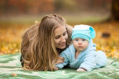 Woman with baby in autumn park Royalty Free Stock Images