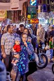 Woman with baby on the bazaar, Tehran, Iran. Tehran, Iran - April 27, 2017: Iranian woman in hijab with a child in her arms stands on the Oriental bazaar near Stock Image