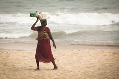 Woman with baby on a beach in Cape Coast, Ghana Stock Image