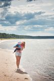 Woman and baby at the beach near sea Stock Photography